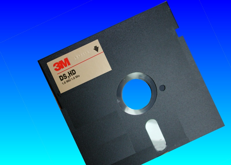 A 5.25 old floppy DS HD (Double Sided High Density) disk.