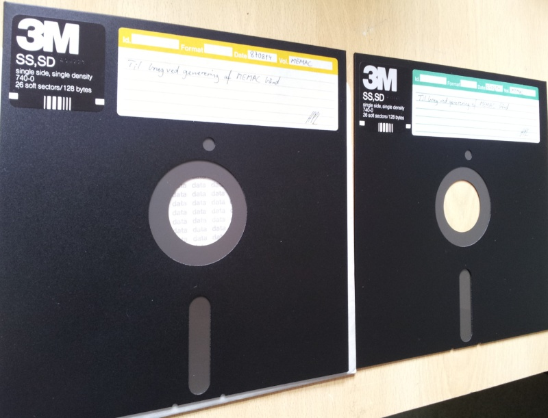 There are 2 off 8 inch floppy disks made by 3M shown side by side awaiting us to recover the files inside the diskettes to a cd or USB. The disks are dark grey in colour and with white hand written labels. Their printed labels indicated 3M SS SD single side single density 740-0 26 soft sectors / 128 bytes.