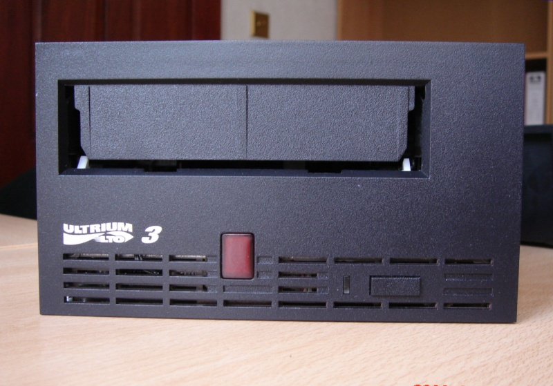 An LTO Ultrium tape drive front face in black used to read LTO1, LTO2 and LTO3 data cartridges and save files to a hard drive.