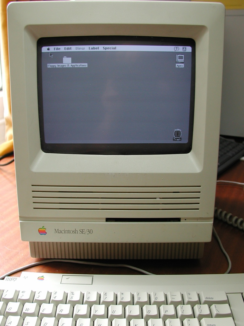 The front screen of an old Macintosh computer made by Apple. This one is an SE-30, but the old Mac used 3.5inch SCSI hard disks connected by flat ribbon cable. The hard drive in this computer was a 1GB Conner as it had been upgraded but usually they were only 20mb, 40mb or 80mb.