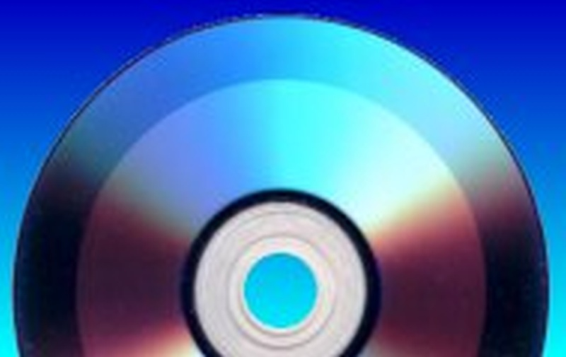 A Double Layer DVD+R turned to face the recording side showing the darker rings where video has already been burnt to the disk.