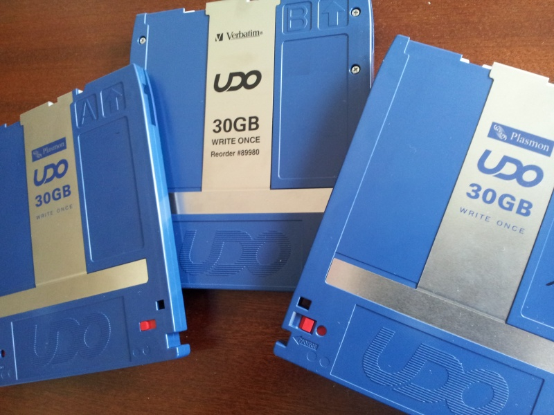 3 UDO disks are shown of 30GB by Verbatim and Plasmon. They were used in an Optical Disk Jukebox which was controlled by Pegasus Inverstore Document Management System. The disks are awaiting transfer of the data and conversion of files to TIF or PDF along with export of Metadata Database.