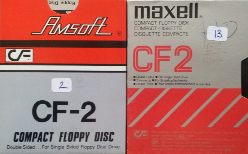 There are 2 CF2 disks made by Amsoft (Amstrad) and Maxell. These disks were sent to be converted to Microsoft Word and are pictured side by side. The discs are still in their original cardboard outer sleeves.