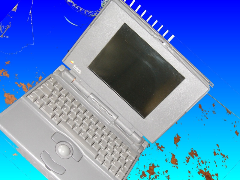 A side view of an Apple Macintosh laptop known as the PowerBook. Inside, there is a 2.5 inch small SCSI hard drive which can range in size from 20mb up to 120mb or even 160mb.