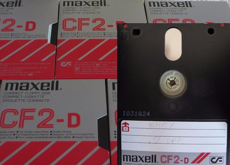 5 off Maxell branded CF-2 floppy disks are shown, most in their cardboard sleeve. One diskin the lower right corner is shown on it's own. The disks are laid out side by side ready for conversion.