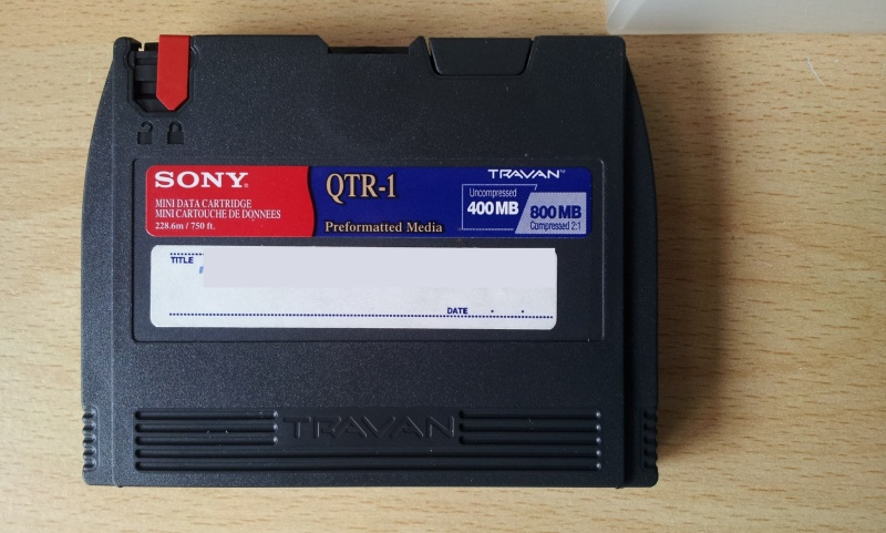 A Sony mini data cartridge QTR-1 Travan tape awaiting file transfer to usb.
