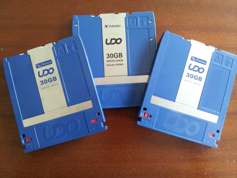 3 UDO disks from a Pegasus Investore jukebox library to be read and have data transfer to USB HDD. The disks are a mixture of Plasmon and Verbatim 30GB Write Once WORM disks.