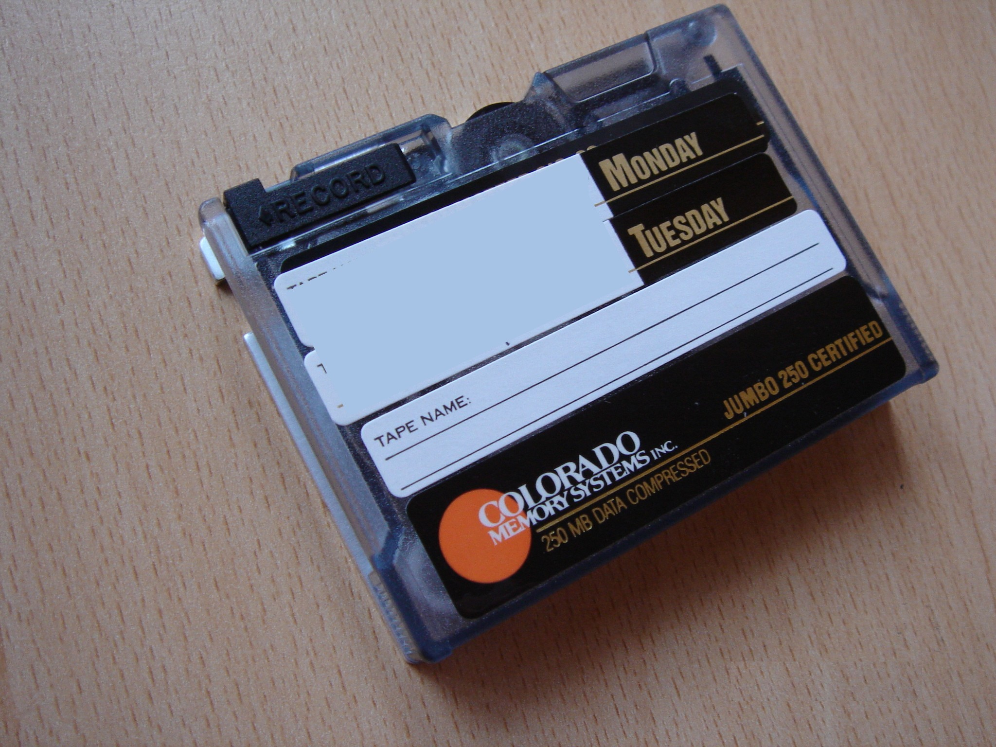 An HP Colorado backup tape that was used in Tracker Jumbo and Surestor cassette drives. These were re-badged QIC Mini-Cartridge with capacity 250mb and 680mb and can be read to USB, CD, DVD or hard drive.