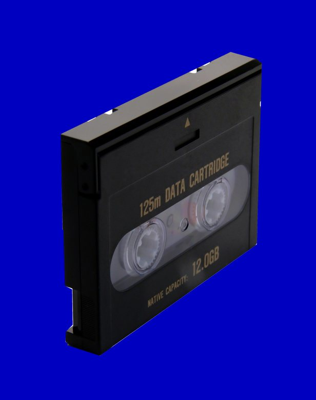 A DAT tape shown at an angle to the camera. The original computer system or software was unknown but it held some vital CAD drawings that needed to be downloaded to USB.