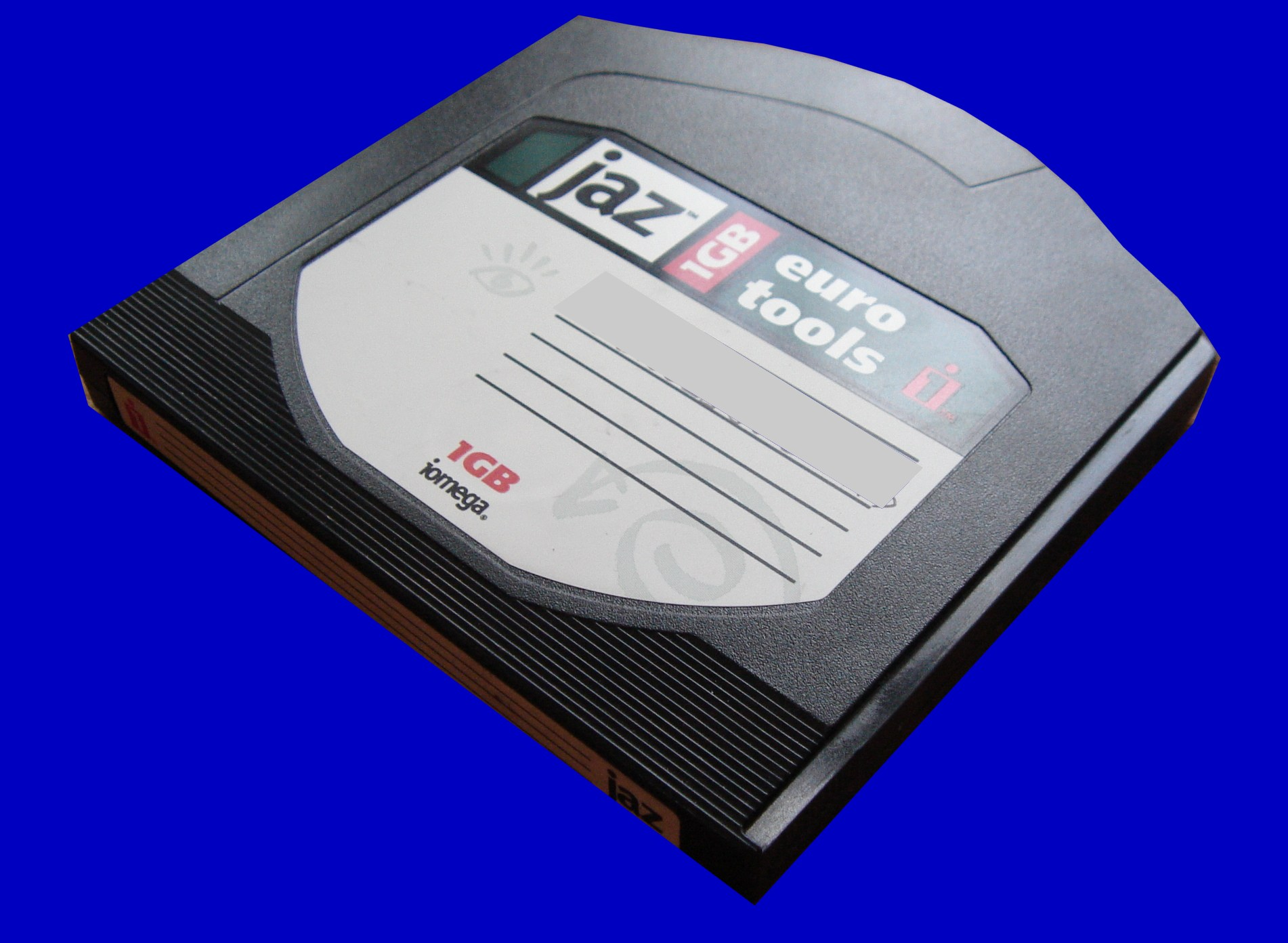 A Backup Jaz disk 1GB laid on its back.