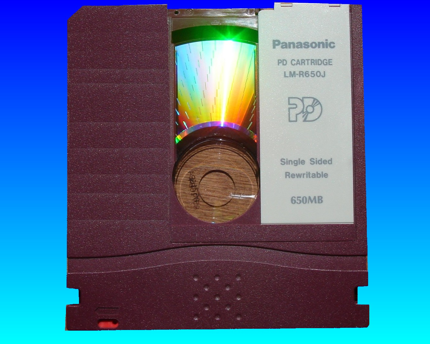 A PD disk cartridge by Panasonic which stored 650mb of data which will shortly undergo transfer to CD.
