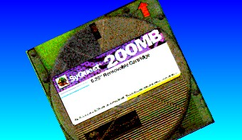 A 200mb Syquest disk cartridge having its files downloaded to DVD.