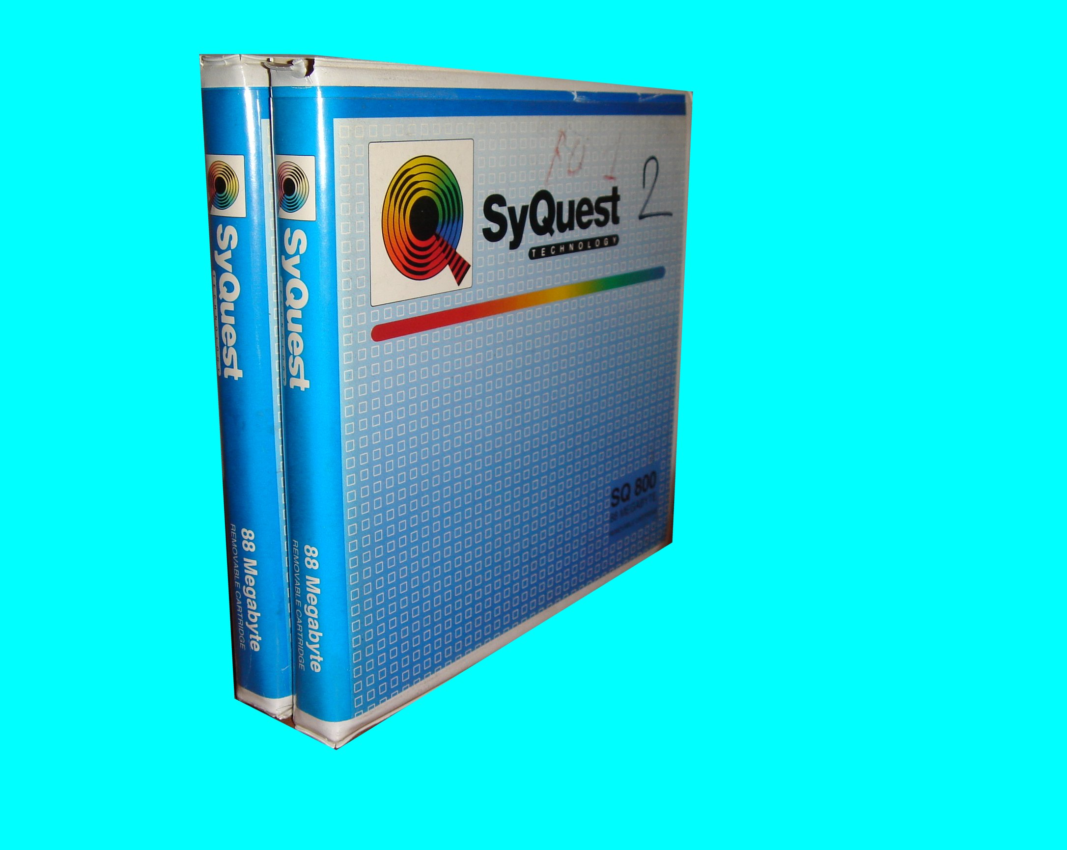 A pair of Syquest Disks that needed their data transferred to CD.