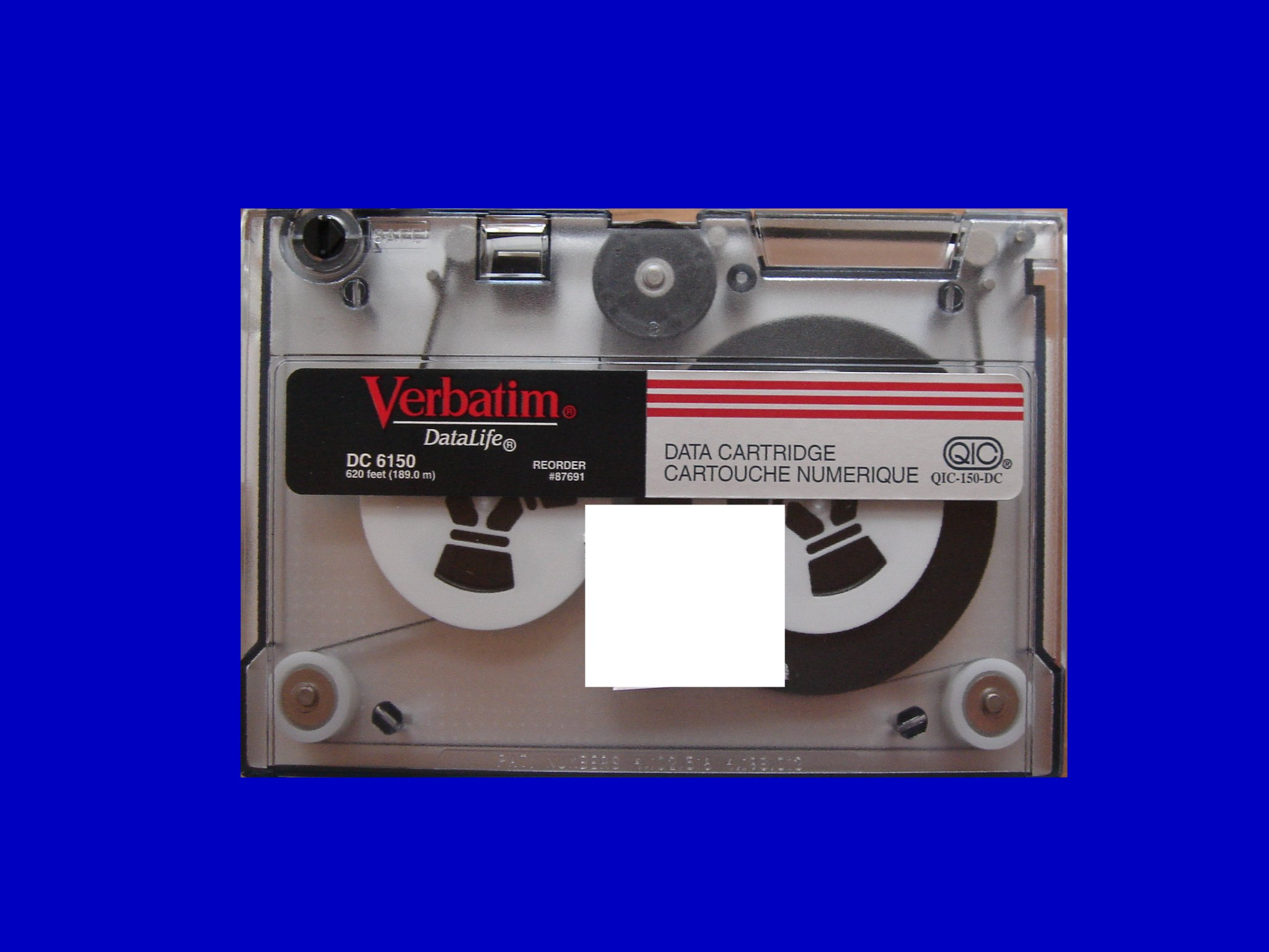 An old 5.25 inch tape cartridge by Verbatim shown against a blue background. This tape was used in Sun Sparc stations and AIX computers. We can dump and restore tar archives from the tpaes to USB, hard drive, CD, or DVD.