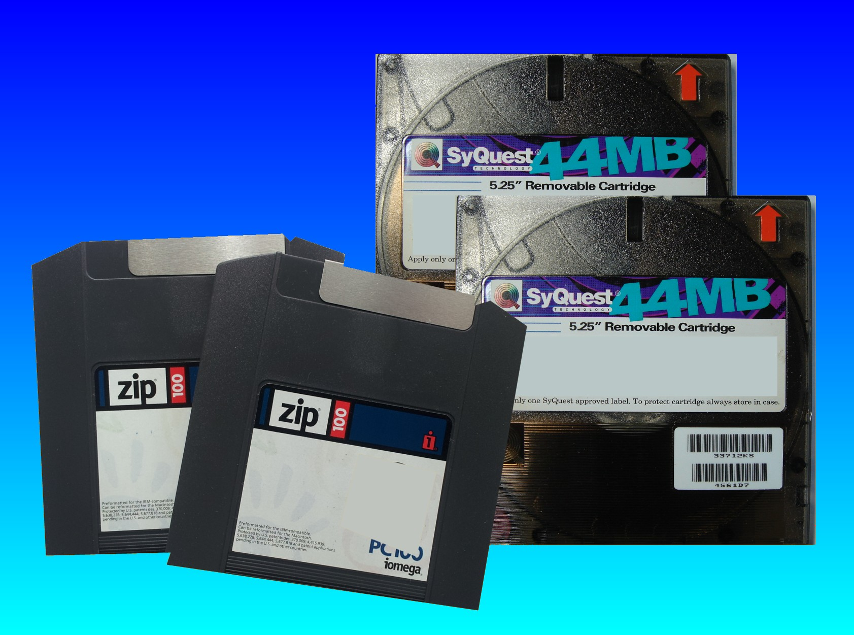 A pair of ZIP 100mb and a pair of Syquest 44mb disks are shown stacked together and awaiting data transfer to email and download files back to the customer. The disks were formatted in an Apple Mac and contained artwork project.