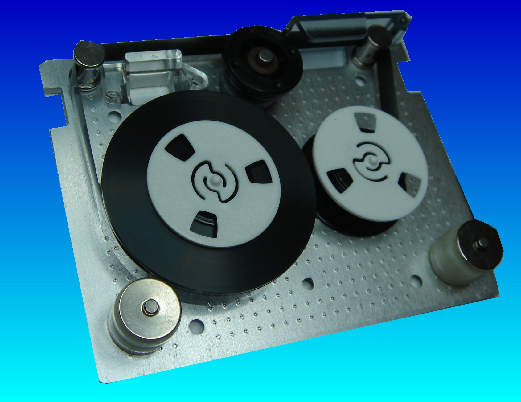 A QIC-80 tape cartridge with it's outer case removed exposing the tape reel mechanisms. These small tapes were  often used in HP Colorado Backup, Windows 95, 98 backups, Seagate and Backpack we have been able to recover the files even when the password was forgotten or the drive belt snapped.