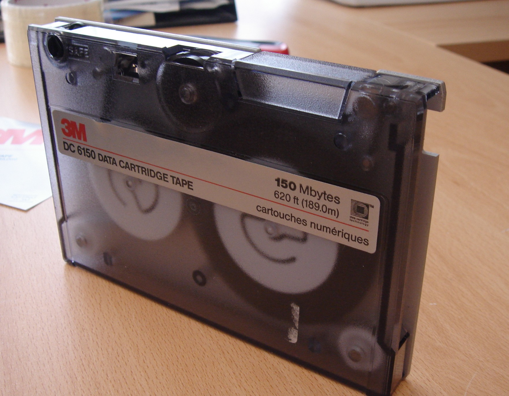 A single tape data cartridge by 3M. This particular model isa DC 6150 150Mbytes labelled cartouche numeriques 620ft long or 189.0m. It was made using windows backup software.