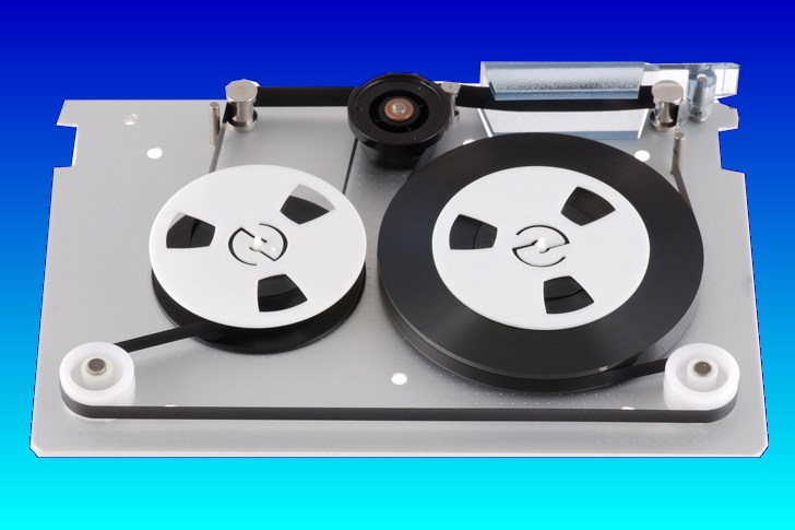 A tape with the top cover removed and showing the reels. We can restore or dump files from tapes and save them to USB, or hard disk.