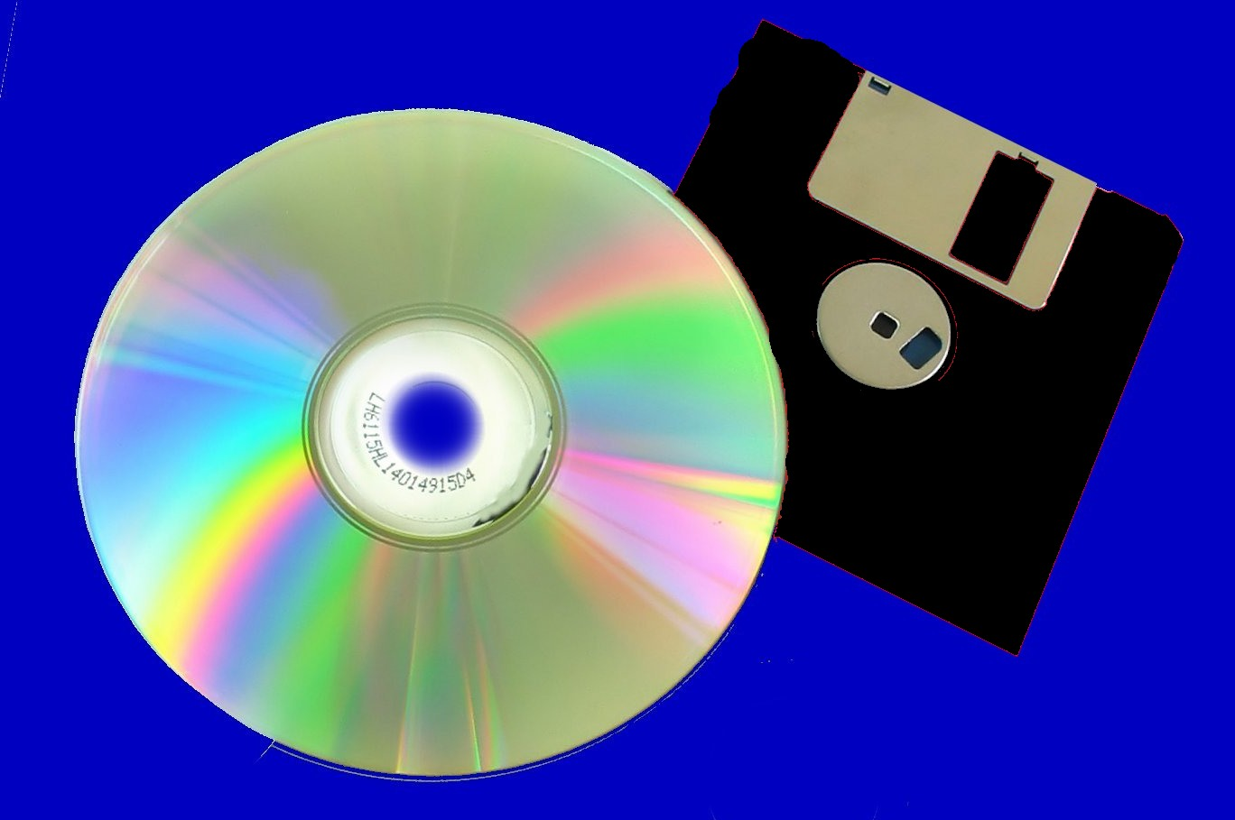A CD and old floppy disk from an Apple computer.