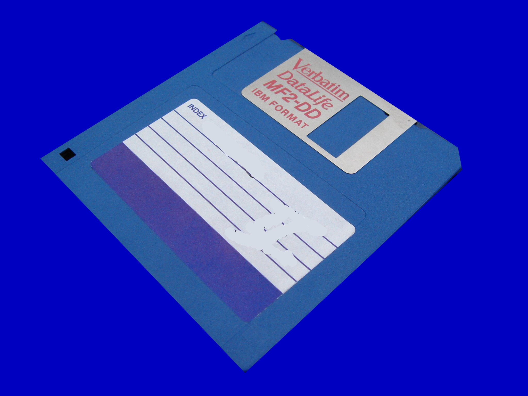 A floppy disk containing old MacWrite word processor files from an Apple OS7 computer.