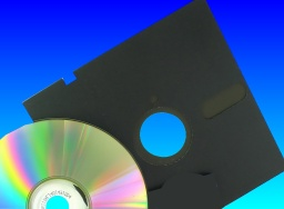 A CD and old floppy disk