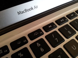 A close up photo of a MacBoook Air. This Apple laptop was model A1466 EMC3178 and the keyboard and screen are clearly shown.