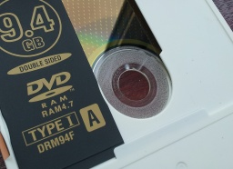 A DVD-RAM made by Imation - 5.2gb Type 1 in a cartridge case. The Recording surface is shown under the outer slide cover. The DVD-RAM was used to store files.