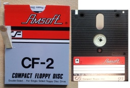 A CF2 floppy disk made by Amsoft is pictured along with it's cardboard outer sleeve. The disc is awaiting a forensic disk image or sector by sector bit by bit exact copy to be made, and have it's files extracted.