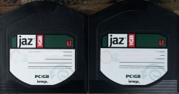A pair of Jaz disks (1GB) that were used in an old Windows PC. The disks stored Paperport and Quicken files. The disks are black in colour and made by Iomega with white labels.